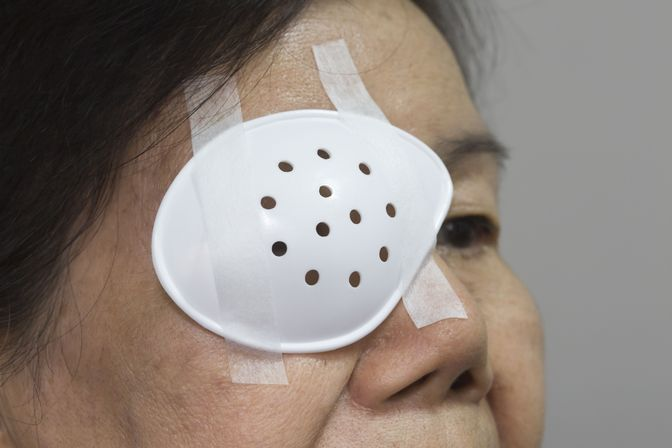 A cataract surgery patient recovering with an eye patch on
