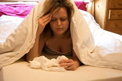 Image of woman in bed sick