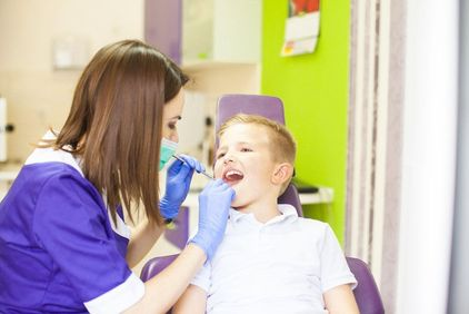 dentist examining a child's mouth