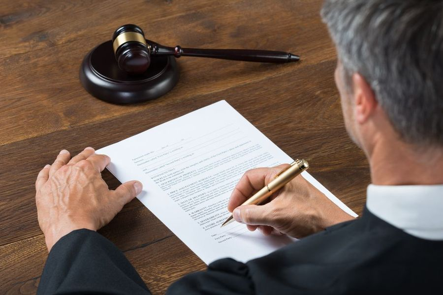 A judge signing a document