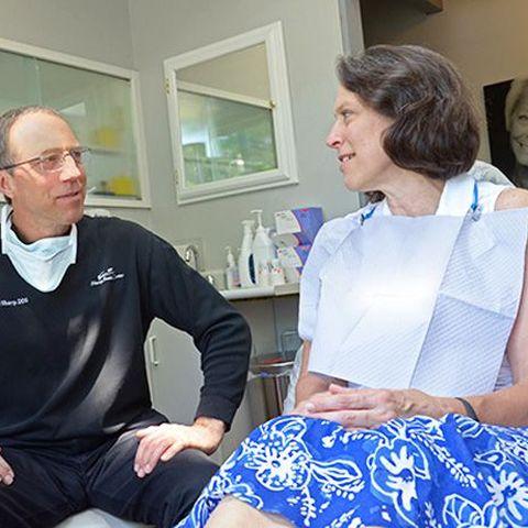 Dr. Michael Sharp confers with a patient