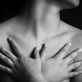 Image of woman with hands over her chest