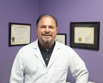 Photo of Dr. Stanmore G. Langford in his office.