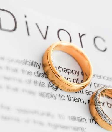 Wedding rings on divorce paperwork