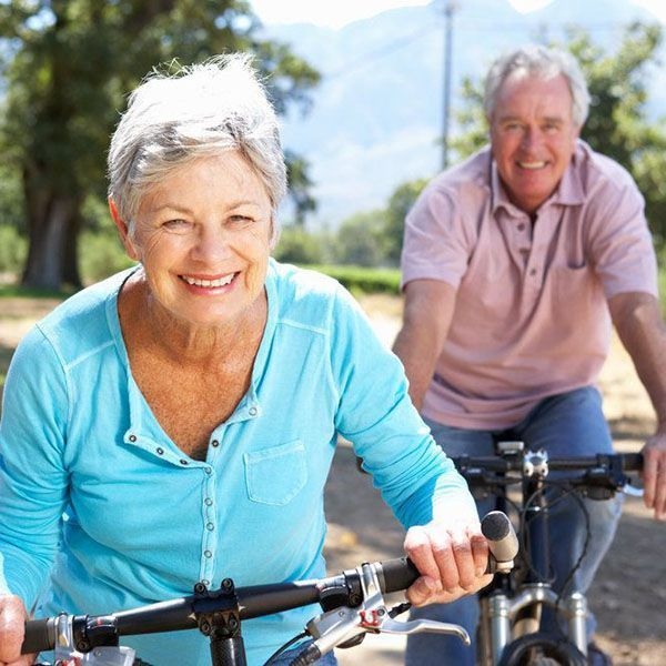 Couple riding bikes smiling